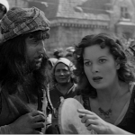 Esmeralda spots an eyes staring Maureen O'Hara 1939 Hunchback of Notre Dame picture image