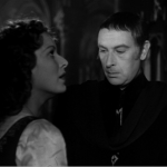 Frollo stares Esmeralda's breasts for 15 seconds Maureen O'hara Sir cedric hardwicke 1939 Hunchback of Notre dame picture image