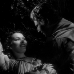 Phoebus and Esmeralda get comfortable  Maureen O'hara Alan Marshal  1939 Hunchback of Notre dame picture image