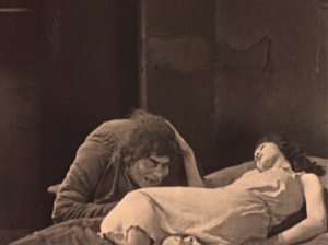 Esmeralda patting Quasimodo on the head Hunchback of Notre Dame 1923 Lon Chaney with Patsy Ruth Miller picture image