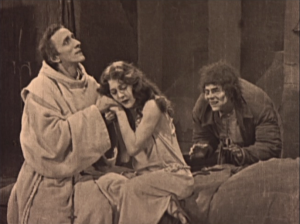 Dom Claude (Nigel de Brulier) with Esmeralda (Patsy Ruth Miller) & Quaismodo (Lon Chaney) 1923 Hunchback of Notre Dame picture image
