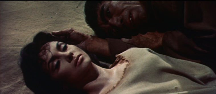 Quasimodo (Anthony Quinn) laying down next to Esmeralda (Gina Lollobrigida) 1956 The Hunchback of Notre Dame picture image