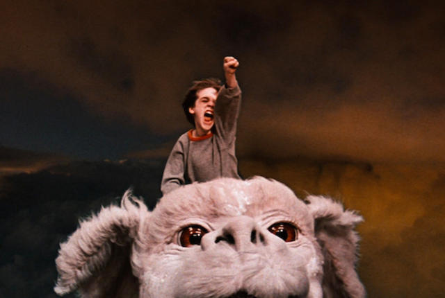 Barret Oliver as Bastian and Falkor The Neverending Story picture image