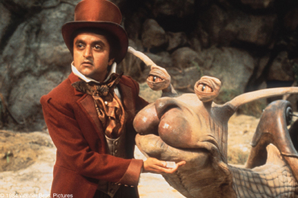 Deep Roy as Teeny Weeny with the Racing Snail The Neverending Story picture image