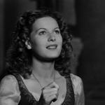 Esmeralda looking at the Virgin Mary (Maureen O'Hara) 1939 Hunchback of Notre Dame picture image