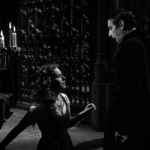 Esmeralda and Frollo (Maureen O'Hara and Sir Cedric Hardwicke) 1939 Hunchback of Notre Dame picture image