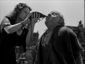 Esmeralda gives Quasimodo a drop of water (Maureen O'Hara, Charles Laughton) 1939 Hunchback of Notre Dame picture image