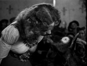 Esmeralda (Maureen O'Hara) and Aristotle share a moment 1939 Hunchback of Notre Dame picture image