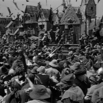 The crowd drags Quasimodo to the stage  1939 Hunchback of Notre Dame picture image