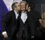 Garou and Patrick Fiori giving Daniel Lavoie a Kiss in Bercy during the Notre Dame de Paris Concert picture image