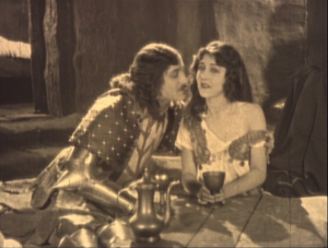 Phoebus (Norman Kerry) revealing Esmeralda's bare shoulder (Patsy Ruth Miller) 1923 Hunchback of Notre Dame image picture