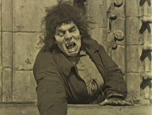Quasimodo points to at the Parisans Hunchback of Notre Dame 1923 Lon Chaney picture image