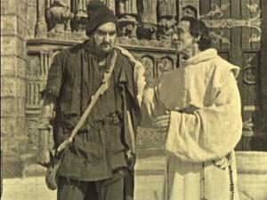 Dom Claude (Nigel de Brulier) with Clopin (Ernest Torrence ) 1923 Hunchback of Notre Dame picture image