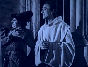 Gringoire (Raymond Hatton) & Dom Claude (Nigel de Brulier) 1923 Hunchback of Notre Dame picture image