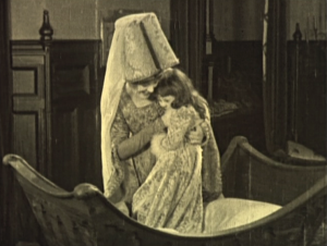 Sister Gudule (Gladys Brockwell) with young Esmeralda Hunchback Notre Dame 1923 picture image
