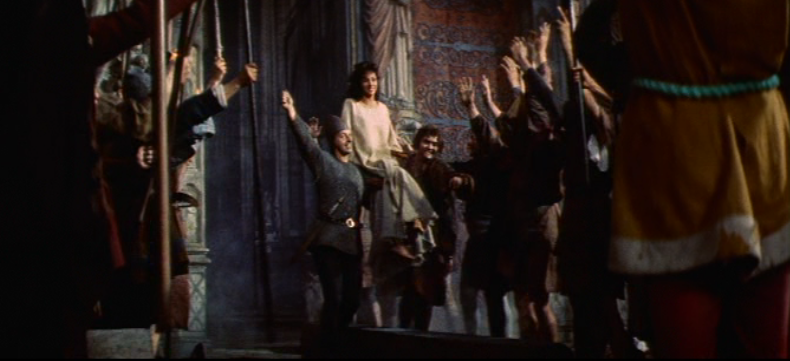 THe Court of Miracles carry Esmeralda (Gina Lollobrigida) out of Notre Dame, 1956 Hunchback of Notre Dame picture image