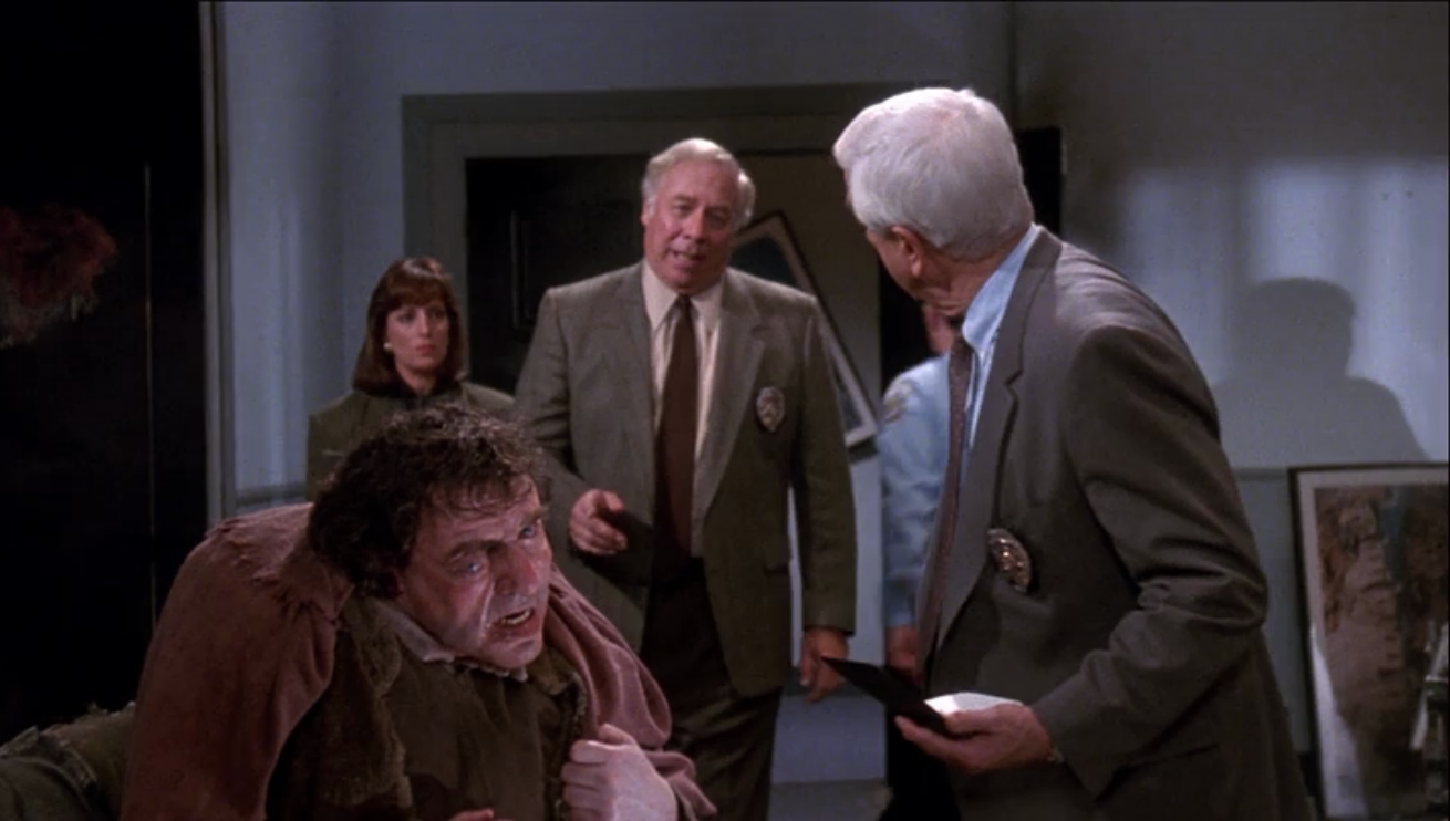 Frank Drebin (Leslie Neilsen) questions Quaismodo in The Naked Gun2 & 1/2 pictureimage