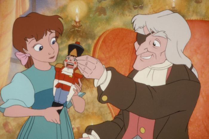 Clara holding the Nutcracker with Drosselmeier The Nutcracker Prince picture image
