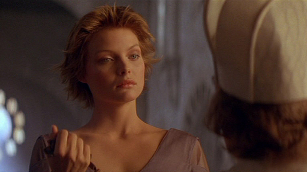 Michelle Pfeiffer as Isabeau with the evil bishop Ladyhawke picture image