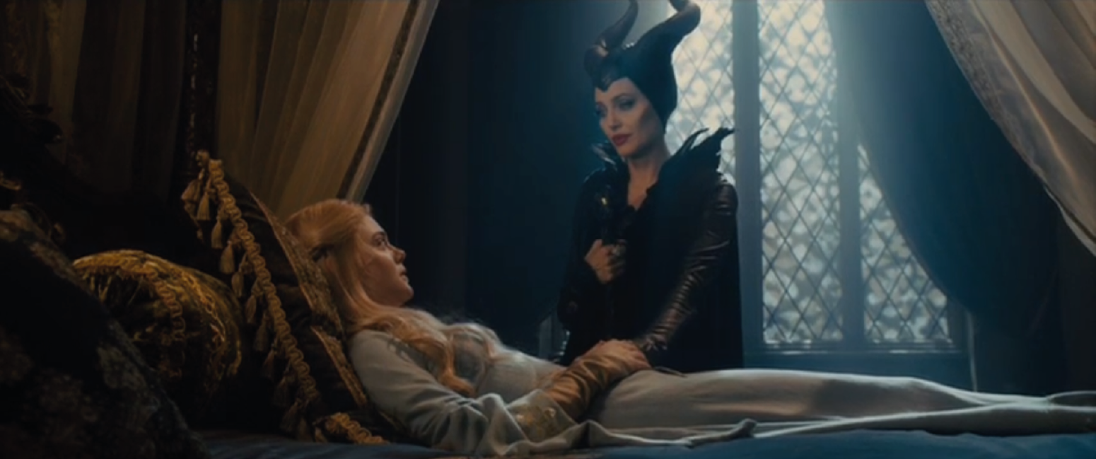 Angelina Jolie as Maleficent with Elle Fanning as Aurora picture image