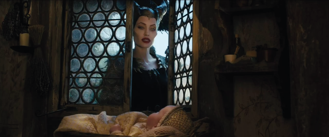 Angelina Jolie as Maleficent with Baby Aurora picture image