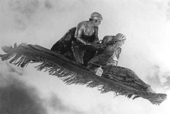 Douglas Fairbanks as Ahmed, the Thief of Bagdad and Julanne Johnston as The Princess flying off together 1924 The Thief of Bagdad picture image