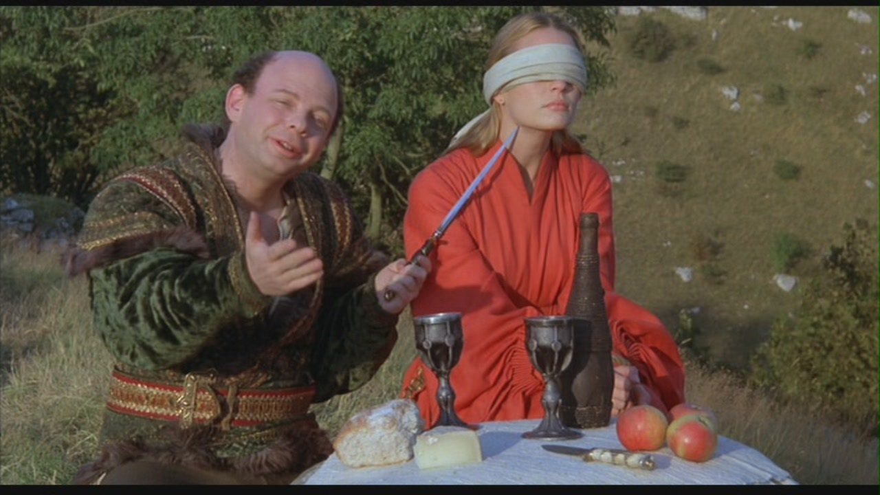 Wallace Shawn as Vizzini with Robin Wright as Buttercup at the Battle of Wit The Princess Bride picture image