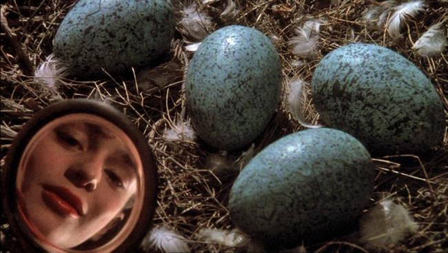 Sarah Patterson as Rosaleen with a nest of eggs In the Company of Wolves